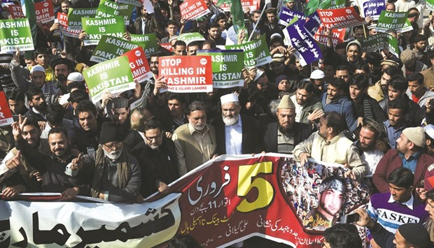 Activists of Jamaat-e-Islami Pakistan march in a protest to mark Kashmir Solidarity Day in Lahore ye