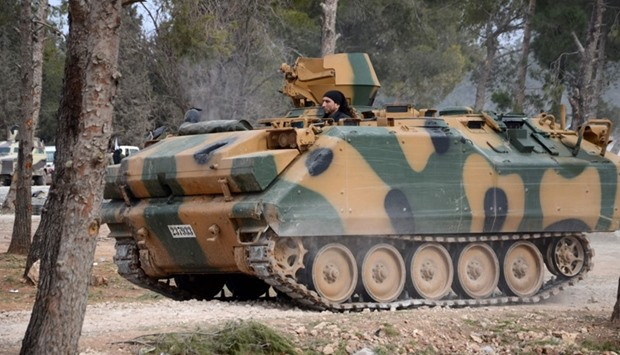 A Syrian rebel, drives a Turkish developed ACV-15 armoured personnel carrier (APC), near Al-Bab