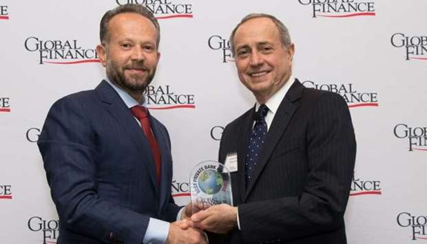 Chaouki Daher, general manager and head of Private Banking at ibq, recieves the award from Global Fi
