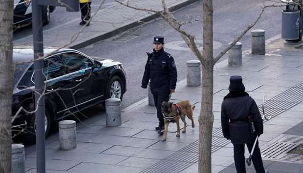 Police patrol outside the Joy City Mall in the Xidan district after a knife attack, in Beijing, Chin