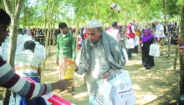 Rohingya refugees receiving aid provided by QRCS and QFFD in Cox's Bazar, Bangladesh