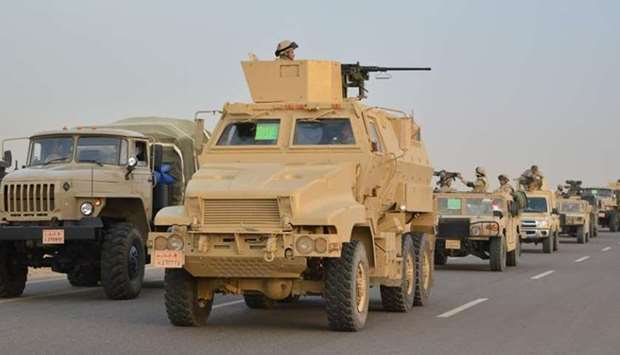 Egyptian Army's Armoured Vehicles are seen on a highway to North Sinai during a launch of a major as