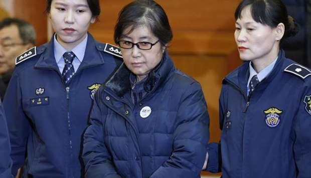 Choi Soon-sil (C), the woman at the centre of the South Korean political scandal and long-time frien