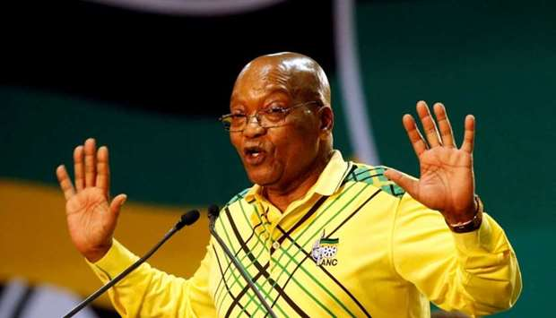 President of South Africa Jacob Zuma gestures to his supporters at the 54th National Conference of t