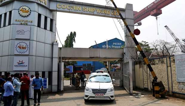 A police vehicle exits Cochin Shipyard Ltd, after a fire broke out on a ship under repair at the shi