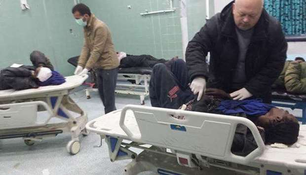 Migrants wounded in the accident being treated at a hospital