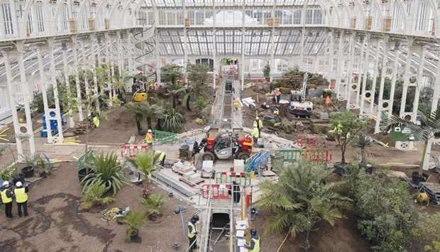 Work progresses inside the Temperate House, the largest surviving Victorian glasshouse in the world,
