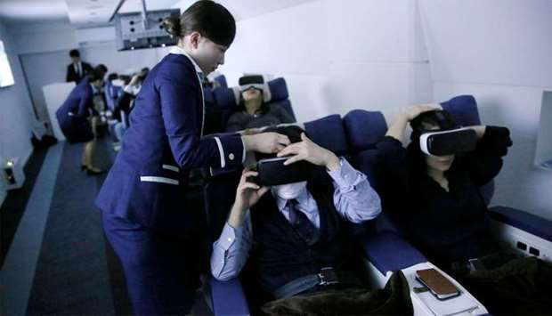 "Staff dressed as flight attendants, help guests to wear VR goggles at the ""First Airlines"", virtual"