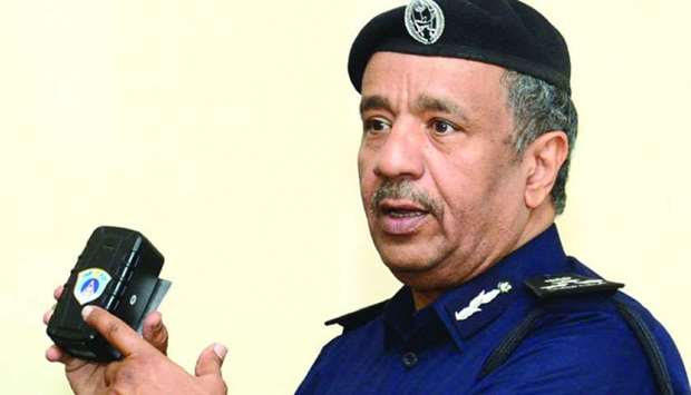 Brigadier Mohamed Saad al-Kharji displays the new smart device for impounding vehicles.