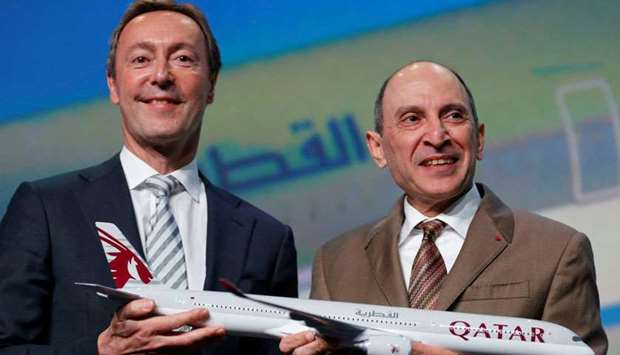 Airbus Chief Operating Officer President Fabrice Bregier and Qatar Airways Chief Executive Akbar Al