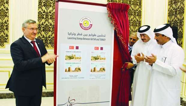 Hassan al-Hail, Fikret Ozer, and Faleh al-Naemi at the unveiling of the stamps