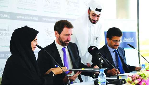 Sidra Medicine and CCQ officials at the MoU signing