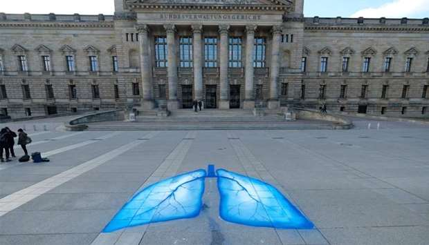 Environmental activists have painted lungs in front of the Federal Administrative Court in Leipzig,