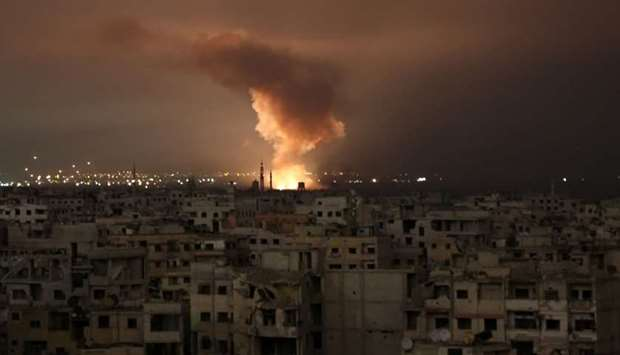 Smoke billows following a regime air strike on the besieged Eastern Ghouta region on the outskirts o