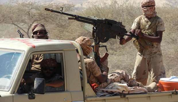 Yemeni fighters loyal to the government backed by the Saudi-led coalition fighting in the country ri