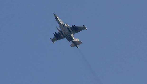 A Sukhoi-25 fighter jet flying over the Syrian city of Saraqib, southwest of Aleppo on Thursday.