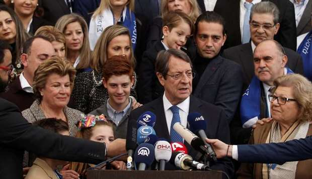 Presidential candidate Nicos Anastasiades talks to the media after casting his ballot