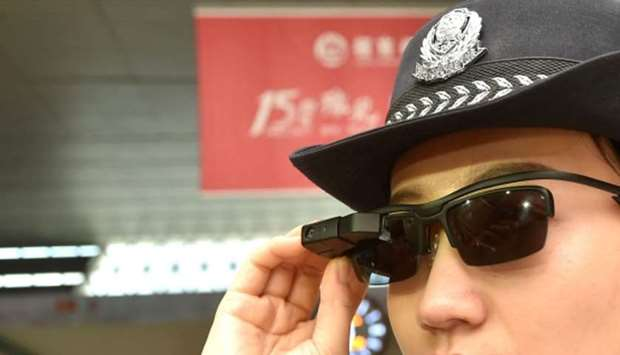 A police officer wearing a pair of smartglasses with a facial recognition system at Zhengzhou East R