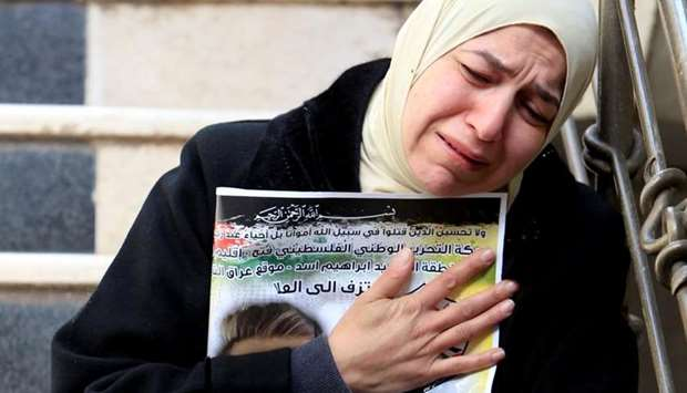 A relative reacts during the funeral of Palestinian Khaled Taeh in Nablus in the occupied West Bank
