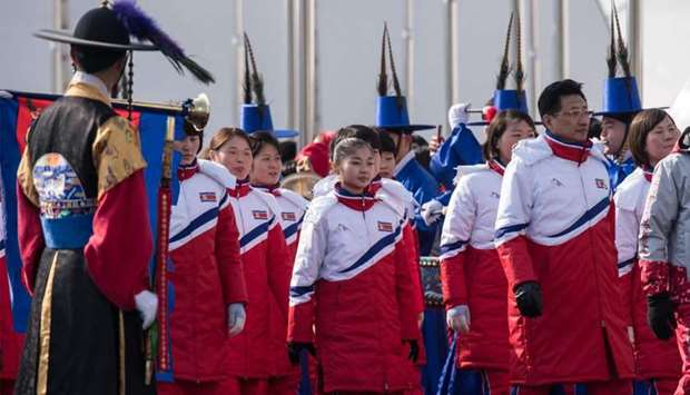 North Korea's athletes arrive for a welcoming ceremony at the athletes village of the 2018 Pyeongcha