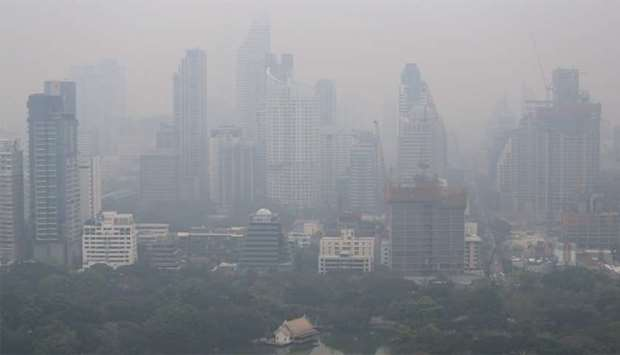 The skyline is seen through morning air pollution in Bangkok, Thailand