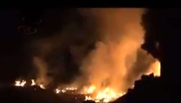 Fire and smoke rises after an airstrike in Afrin last night.
