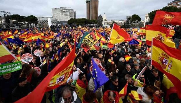 Right-wing protesters wave Spanish flags during a demonstration in Madrid against Spanish Prime Mini