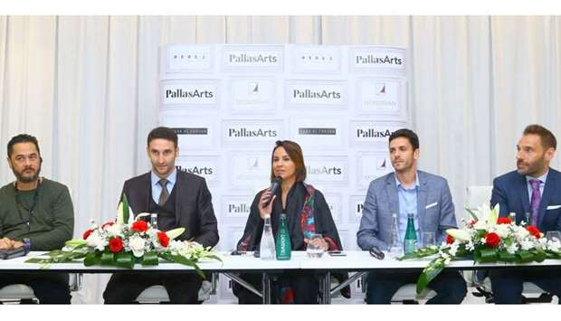 Pallas Arts co-founder Mariame Farqane delivering a brief history of the brokerage, while looking on