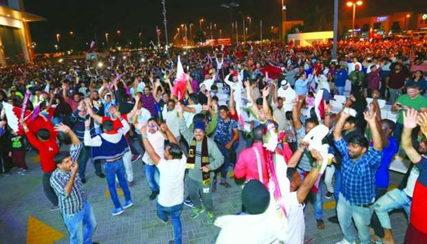 Spectators dance after Qatar claimed the Asian Cup.