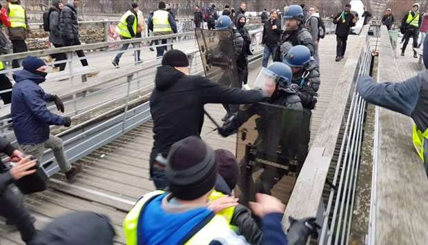 Christophe Dettinger as he takes a boxing stance while clashing with riot police
