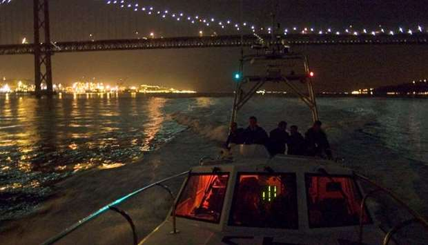 A police patrol boat leaves Lisbon harbour on its way to the open sea to hunt for drug runners in th