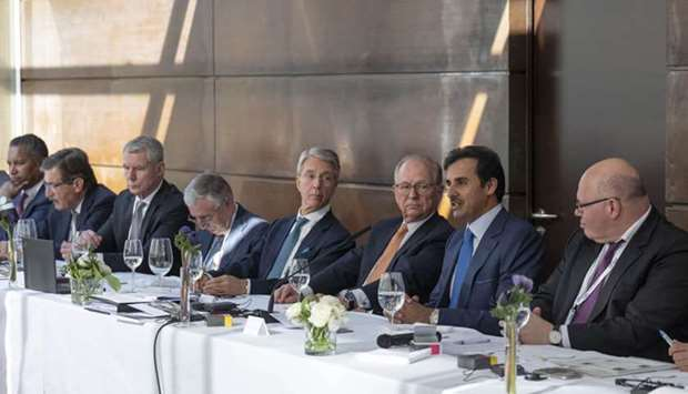His Highness the Amir Sheikh Tamim bin Hamad Al-Thani attends a luncheon banquet accompanied by Wolf