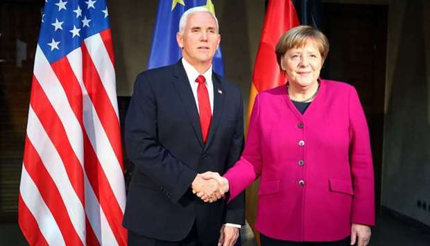 US Vice President Mike Pence shakes hands with German Chancellor Angela Merkel