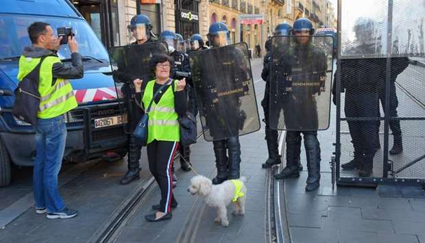 French gendarmes face protesters during a yellow vest (gilets jaunes) anti-government demonstration