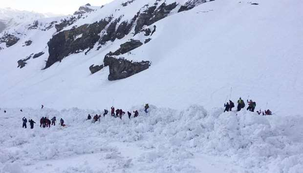 rescuers on the site of a avalanche that left four skiers injured above the ski resort of Crans-Mont