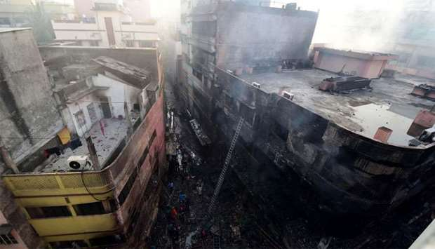 Burnt buildings are seen after a fire broke out in Dhaka. At least 69 people have died in a huge bla