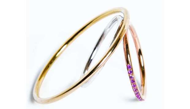 Wires in Gold ring in yellow, rose and white gold, pink sapphire.
