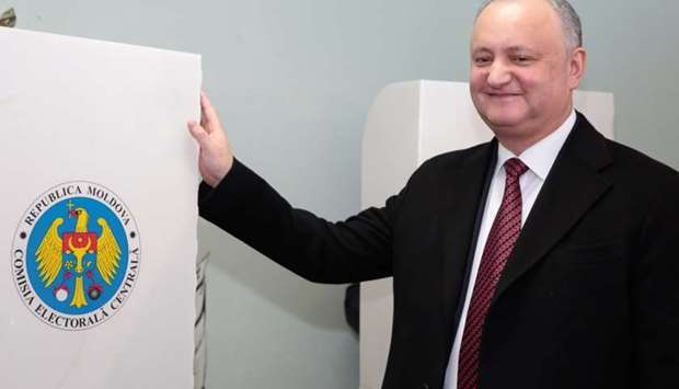 Moldovan President Igor Dodon visits a polling station during a parliamentary election in Chisinau.