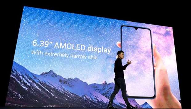 Xiaomi's Director of Product Management Donovan Sung presents the new Xiaomi Mi 9 mobile phone ahead