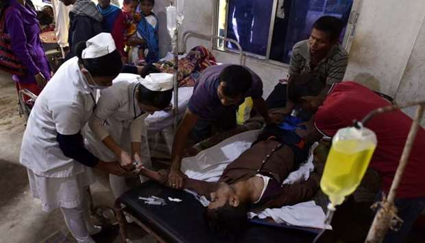 A patient who drank toxic bootleg liquor is treated at Kushal Konwar Civil Hospital in Golaghat
