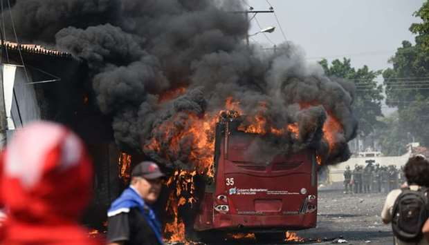 A bus burns down during a protest in the border city of Urena, Tachira