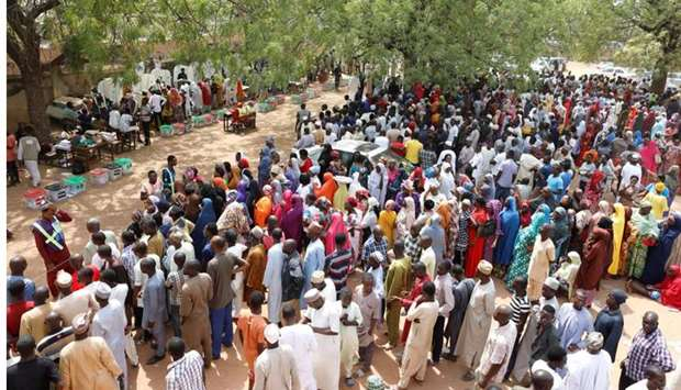 People gather to vote during Nigeria's presidential election at a polling station in Yola, Nigeria