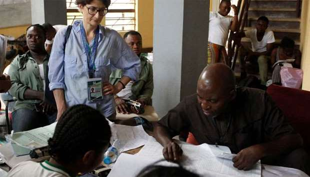 A foreign election observer monitors a collation center, as Nigerians await the results of the Presi
