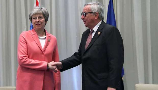 Theresa May poses with European Commission President Jean-Claude Juncker