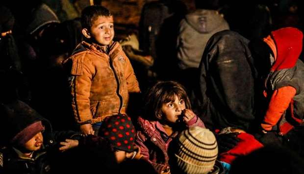 Women and children evacuated from the Islamic State (IS) group's embattled holdout of Baghouz wait i