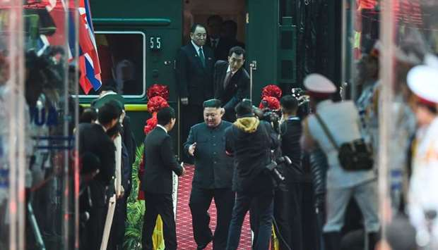 North Korean leader Kim Jong Un (C) arrives at the Dong Dang railway station in Dong Dang, Lang Son