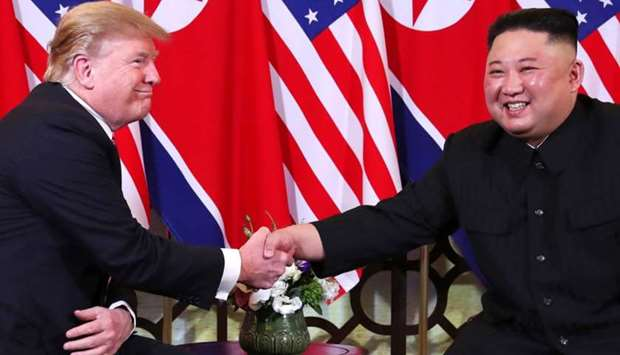 US President Donald Trump and North Korean leader Kim Jong Un shake hands before their one-on-one ch