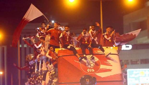 The Qatar national football team during their parade on an open-top bus last evening.
