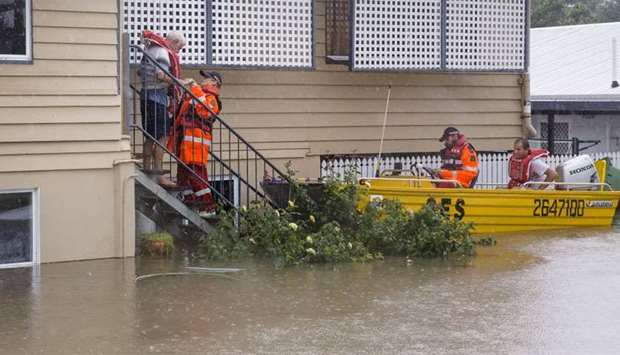 SES volunteers are seen rescuing residents in Rosslea, Townsville, Queensland, Australia