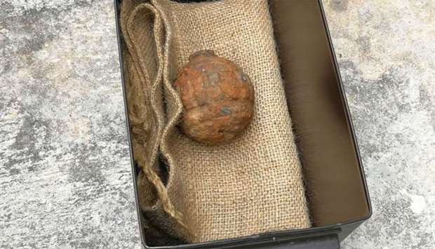 Hong Kong Police Force shows World War I-era German hand grenade that was found among a shipment of